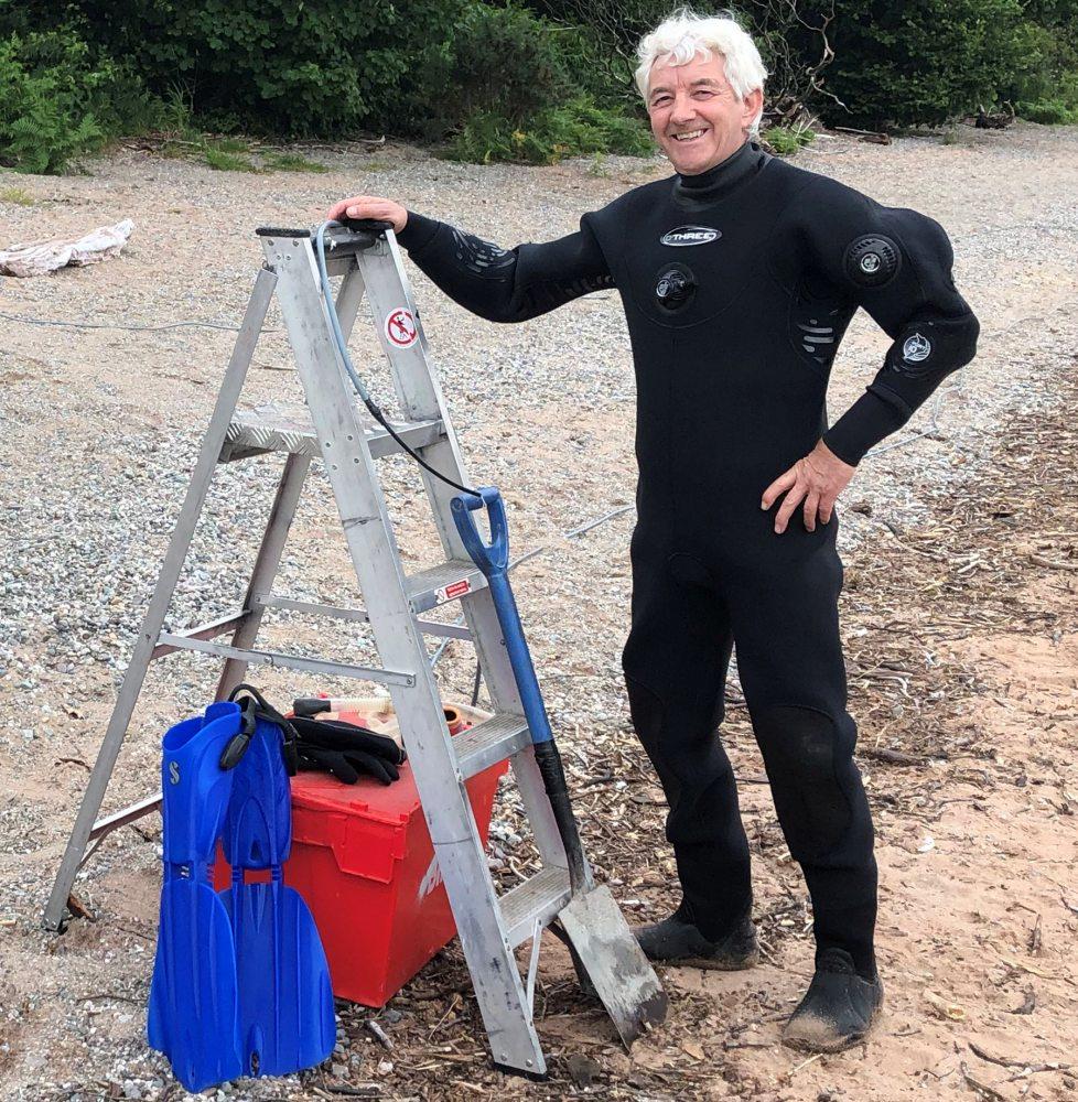 John-McConnell-next-to-ladder-at-Loch-Lomond