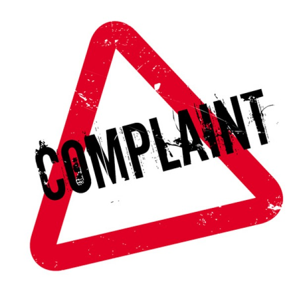 consumer complaint uk red triangle warning sign