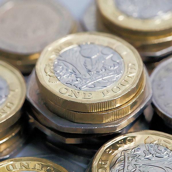 pound coins pile uk