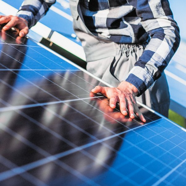 Man worker in the firld by the solar panels,Man worker in the firld by the solar panels