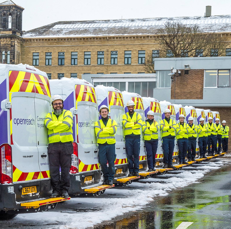 openreach engineer uk team and vans in snow
