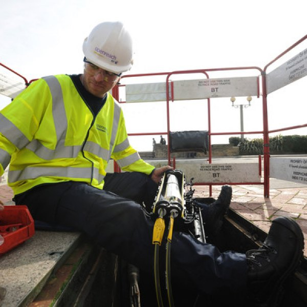 bt openreach engineer cable duct manhole uk