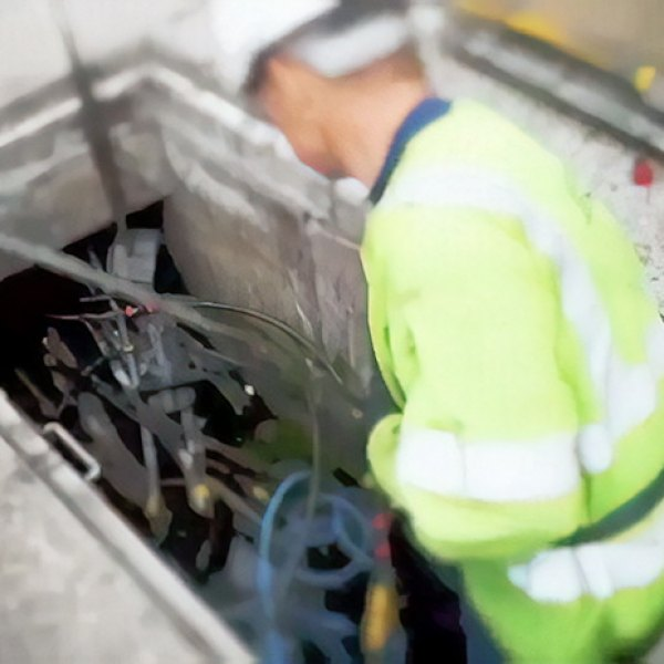 bt openreach fibre optic engineer in cable duct