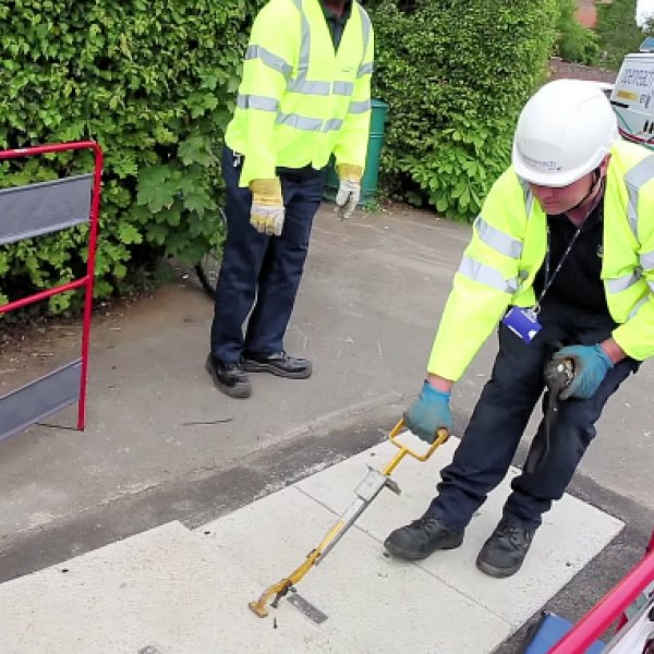 manhole and two openreach engineers