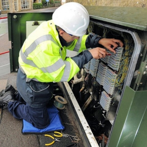 openreach bt engineer at a street cabinet fttc
