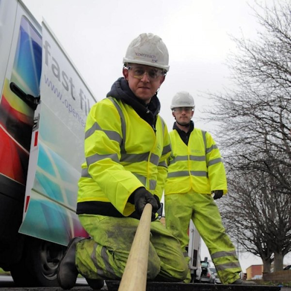 openreach engineer pulling fibre optic cable duct