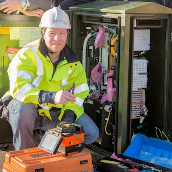 openreach fttc cabinet with engineer smiling