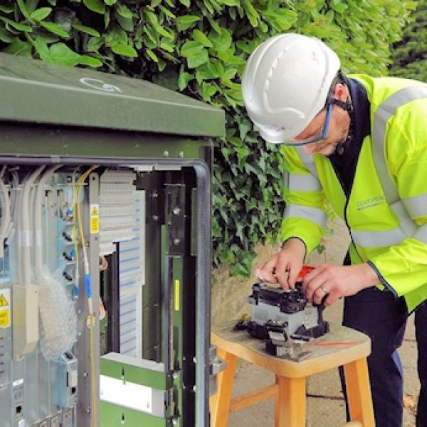 openreach fttc street cabinet engineer with beard working