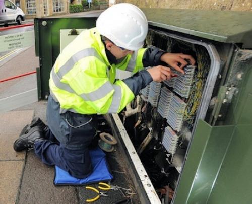 openreach bt engineer at a street cabinet fttc