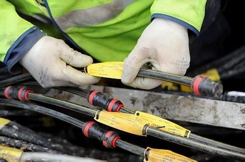 fibre optic cables bt engineer hands