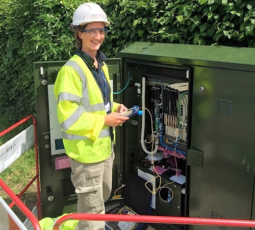 female openreach engineer at an fttc cabinet