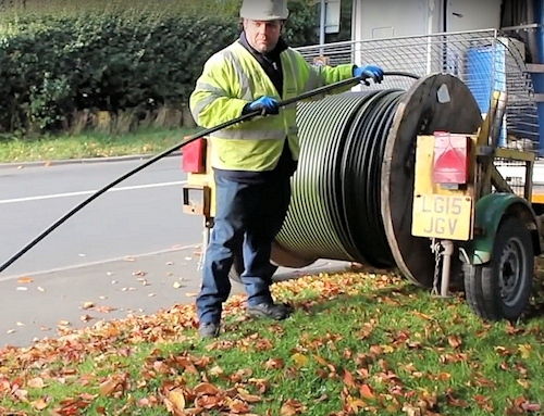 openreach engineer with drum of fibre optic cable