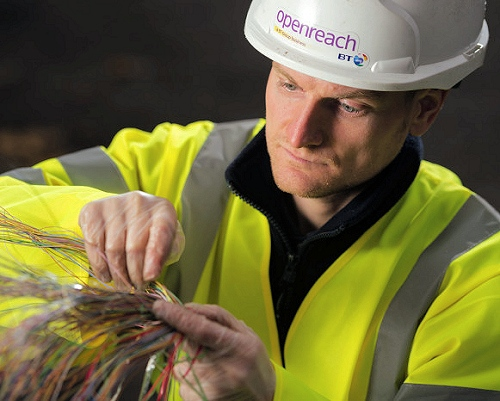 engineer touching broadband cables openreach bt