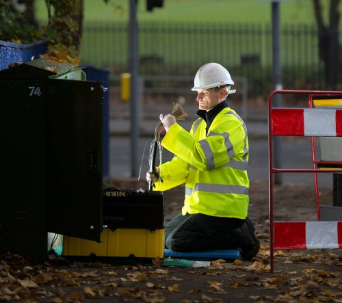 engineer bt looking at telecoms and broadband cables