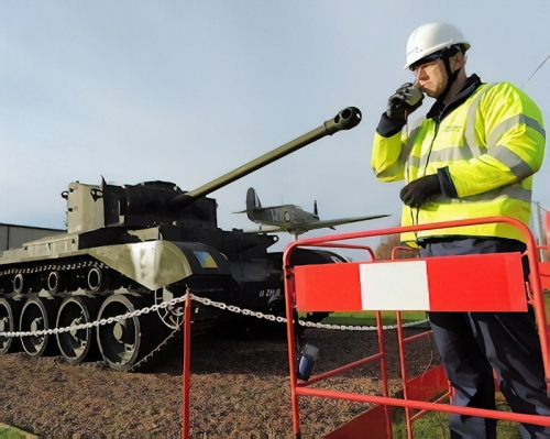 tank pointing at bt openreach engineer long