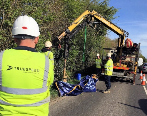 truespeed fibre optic cable install on road