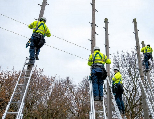 telegraph pole three openreach bt engineers