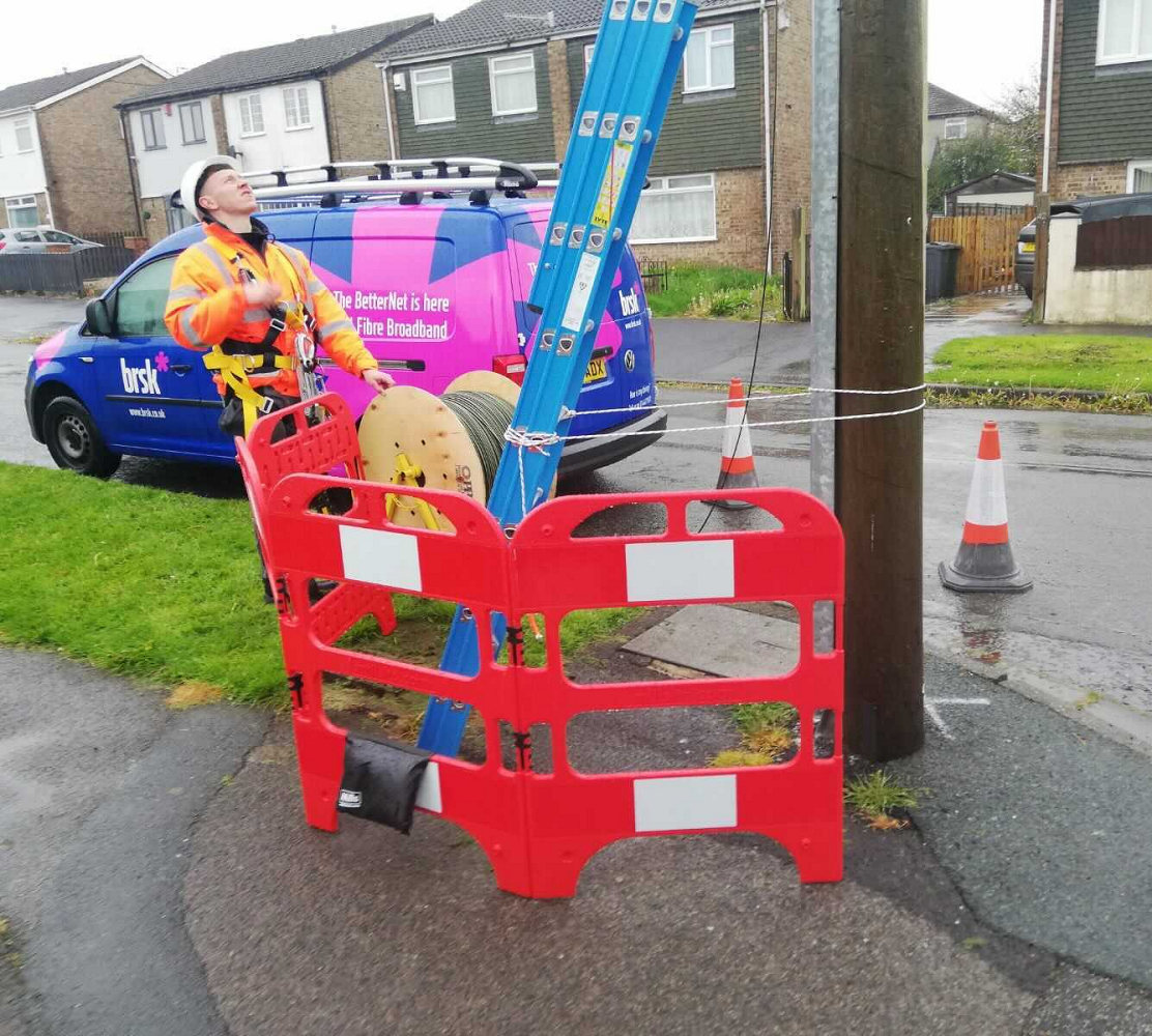 Brsk engineer next to telegraph pole
