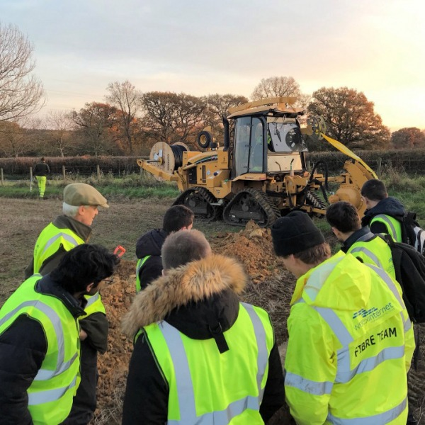 wessex internet fibre team in field tractor