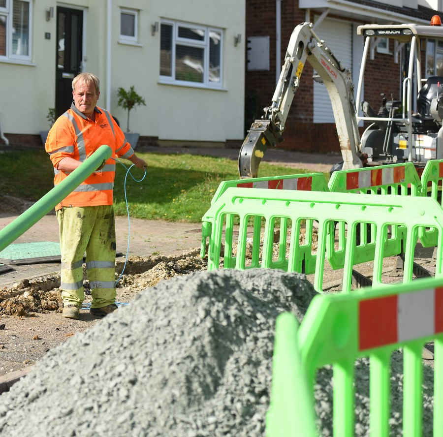 county broadband engineer holding fibre duct ftth