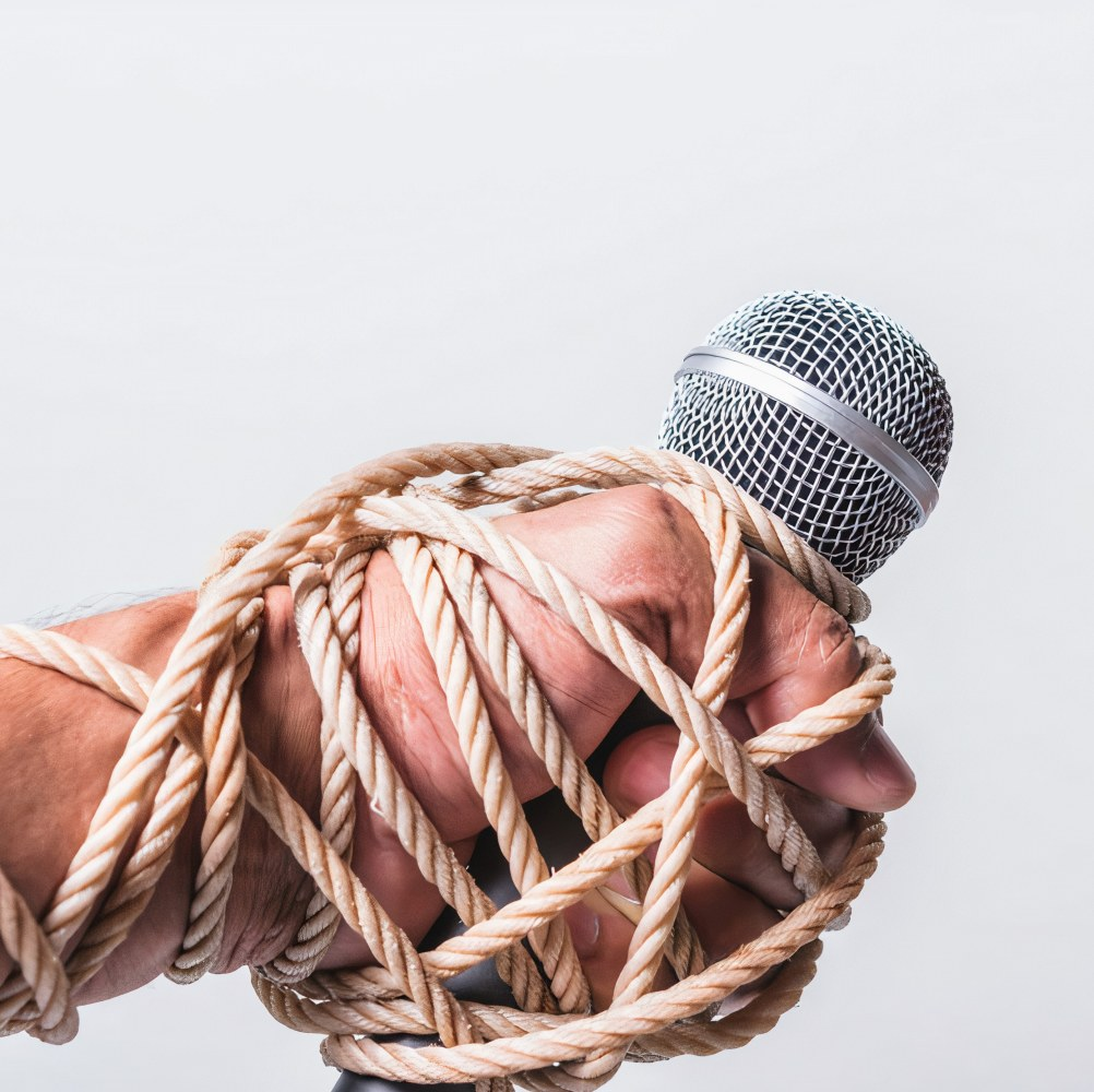 Censorship image of hands bound by rope