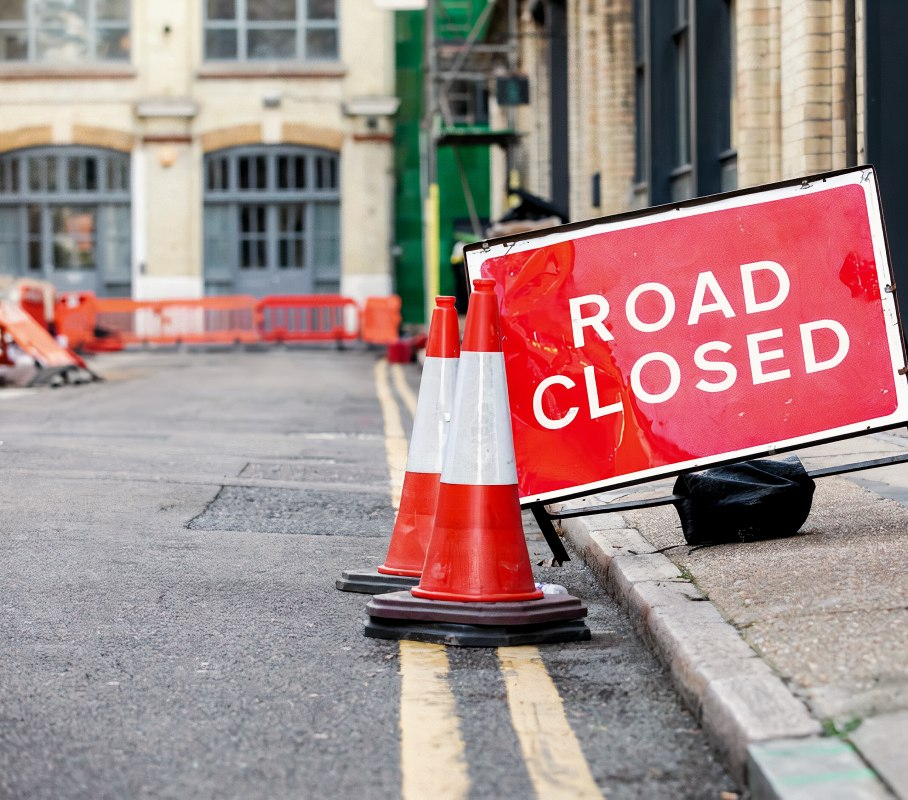 Red Road Closed road sign in a UK city street.