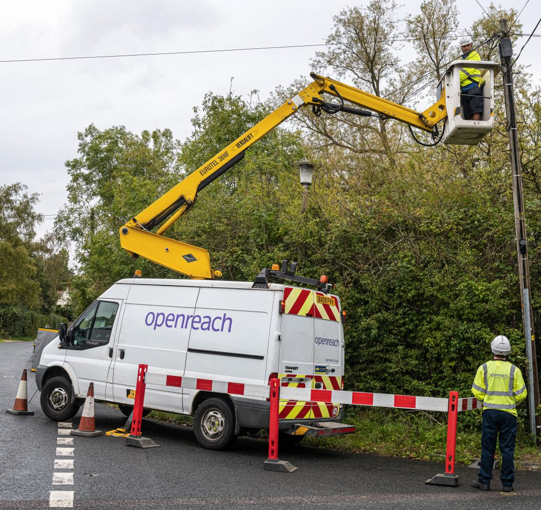 van_and_openreach_fttp_engineer_on_telegraph_pole_photo