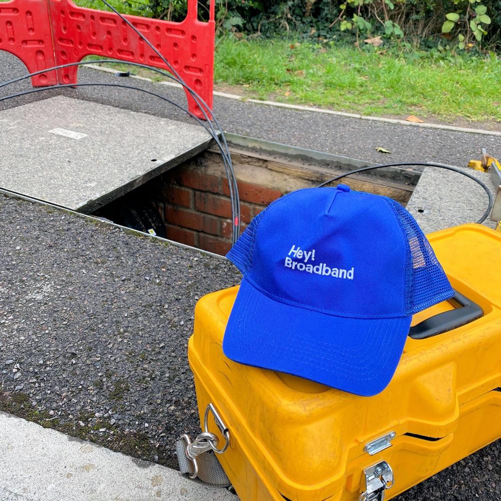 hey-broadband-engineer-fwn-hat-by-manhole