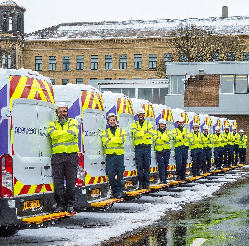openreach engineer uk team and vans in snow