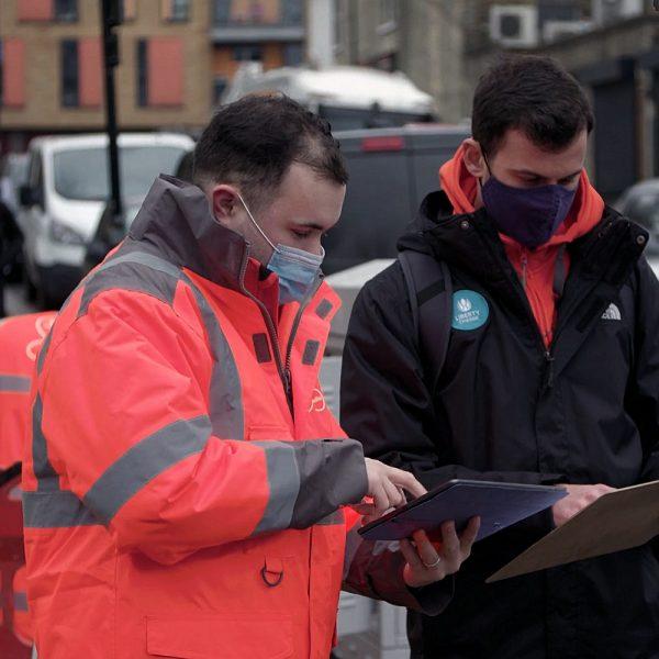 virgin media uk engineer in rain jacket