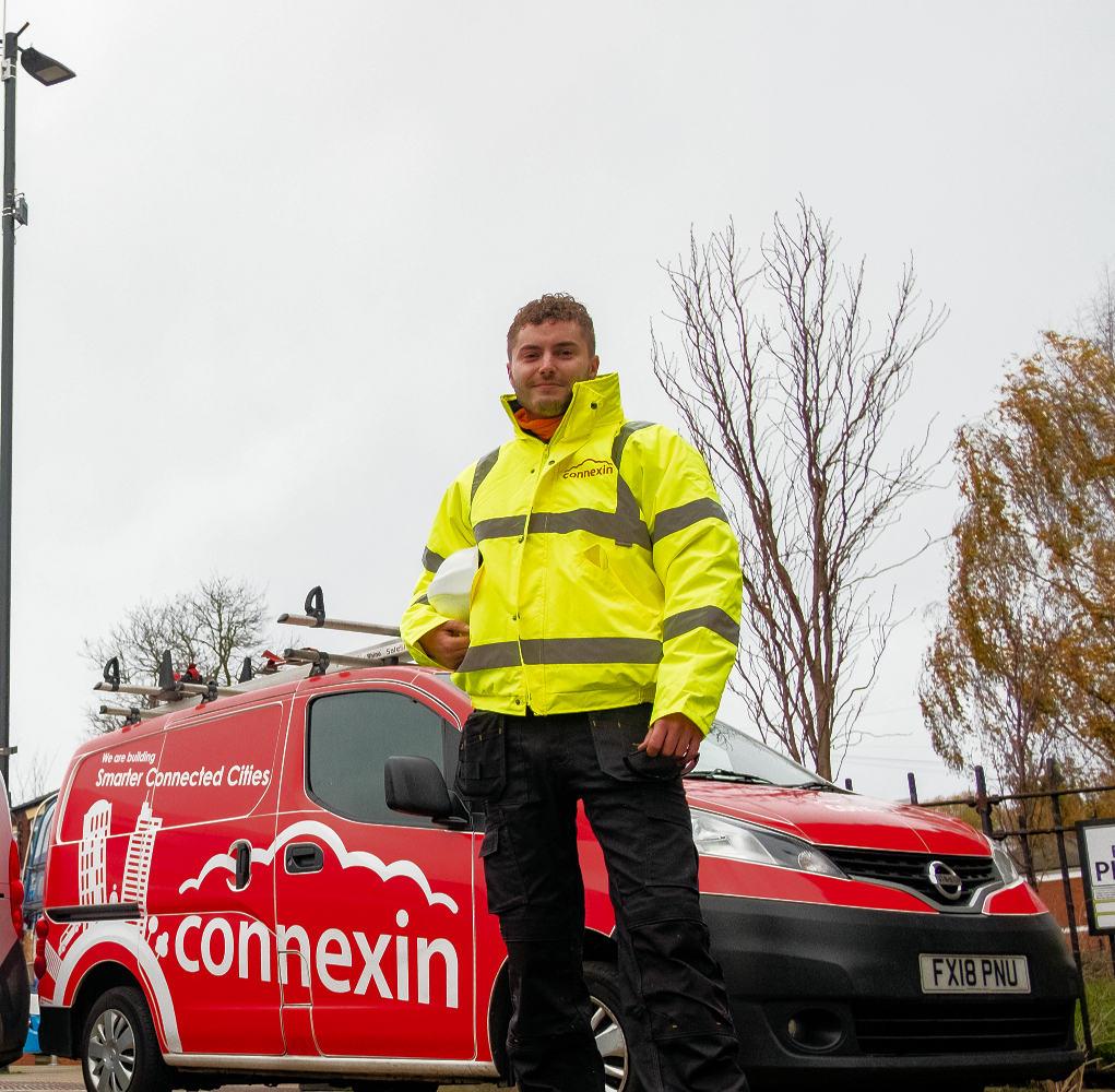 Connexin Engineer Next to Van
