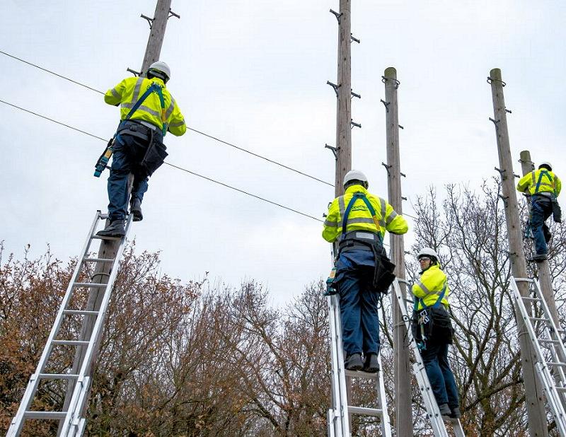 telegraph pole three openreach bt engineers